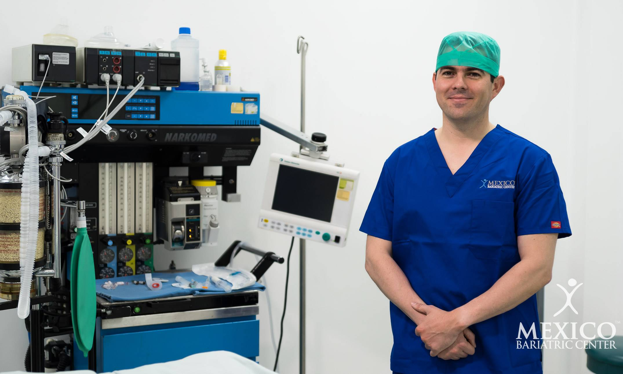 Dr Alejandro Gutierrez in operating room with bariatric equipment